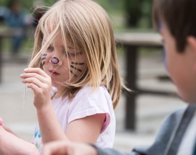Ali Graham picks marshmallow out of her hair during Daraja's annual kite festival at Bowness Park in Calgary on Saturday, June 13, 2015. The kite festival is held to raise money for causes in Stone Town, Zanzibar. (Photo by Kyle Meller)