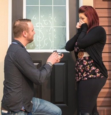 Brandon Higginson proposes to Katie Roy in Airdrie on Friday, Aug. 28, 2015. They have been dating for five years. (Photo by Kyle Meller)