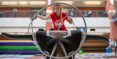 Joanna Pieczka lassoes a toy bull during SAITSA Fun Day on campus in Calgary on Thursday, Sept. 10, 2015. SAITSA Fun Day is held during the first week of school to welcome full-time students back to campus. (Photo by Kyle Meller)